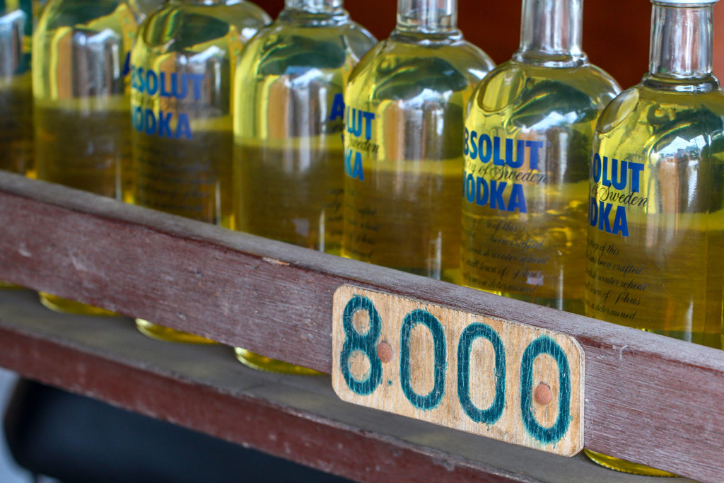 Petrol for motorbikes is sold in discarded Absolut vodka bottles and sold for 8000 Indonesia rupiah (about 0.60 USD, at the time of writing)