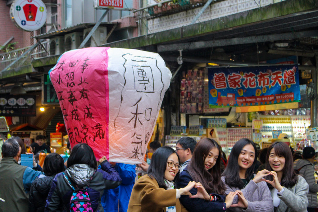 On one tour, we built our own paper lantern to set loose into the sky. This picture was snapped while a group of girls posed with their lantern for another camera.