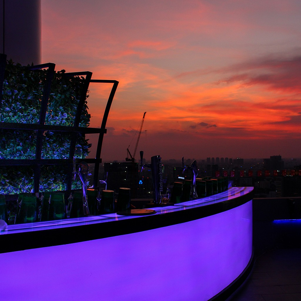 A swanky rooftop bar during sunset in Ho Chi Minh City, Vietnam.